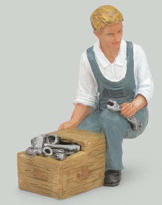 Mechaniker, kniend